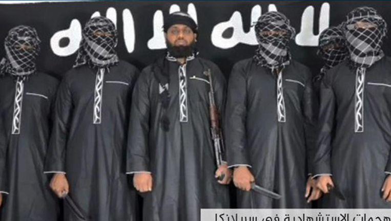 De vermeende aanslagplegers met in het midden de man die het brein zou zijn geweest: Zahran Hashim. Beeld AFP