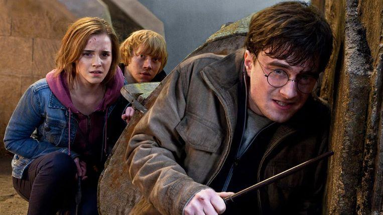 Vanaf links: Emma Watson, Rupert Grint en Daniel Radcliffe in Harry Potter and the Deathly Hallows: Part 2 van David Yates Beeld