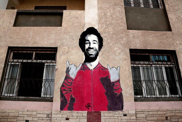 Tekening van Salah op de muur van een jongerencentrum in Egypte. Beeld AP
