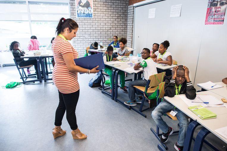 De schoolsluiting kwam het hardst aan bij scholen waar al een risico op achterstand was. Beeld Mats van Soolingen/ANP