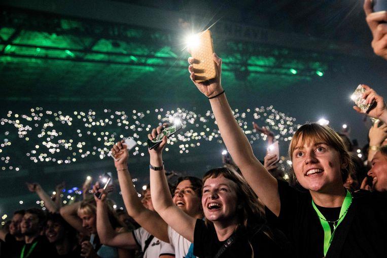Concertgangers in Denemarken op 11 september. Als eerste land in West-Europa ging Denemarken deze week weer helemaal open.  Beeld AFP