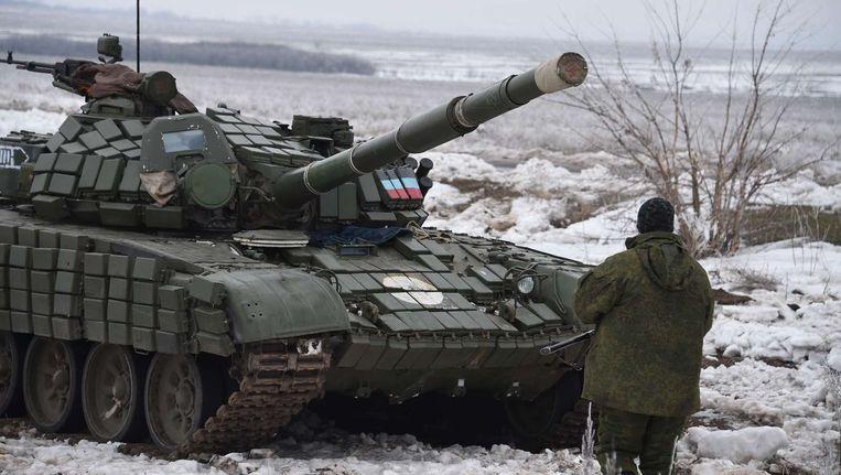 Pro-Russische separatisten met een tank in het oosten van Oekraïne. Beeld AFP