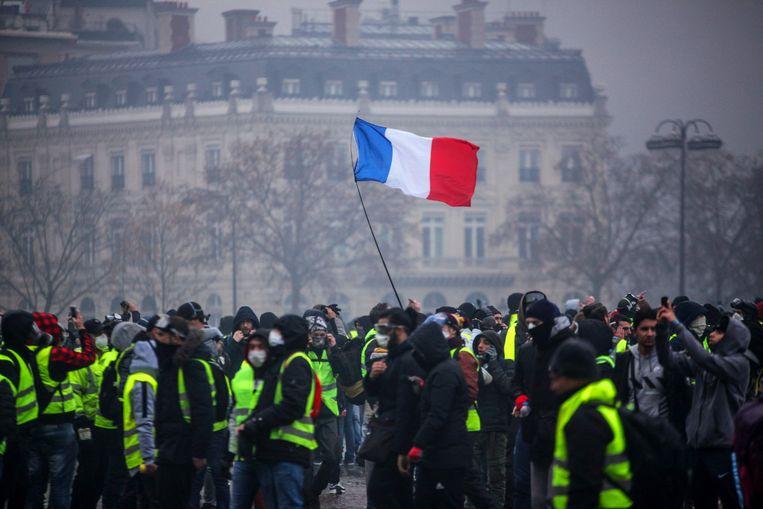 Een demonstratie van de 'gilets janues' afgelopen weekend in Parijs.  Beeld AFP
