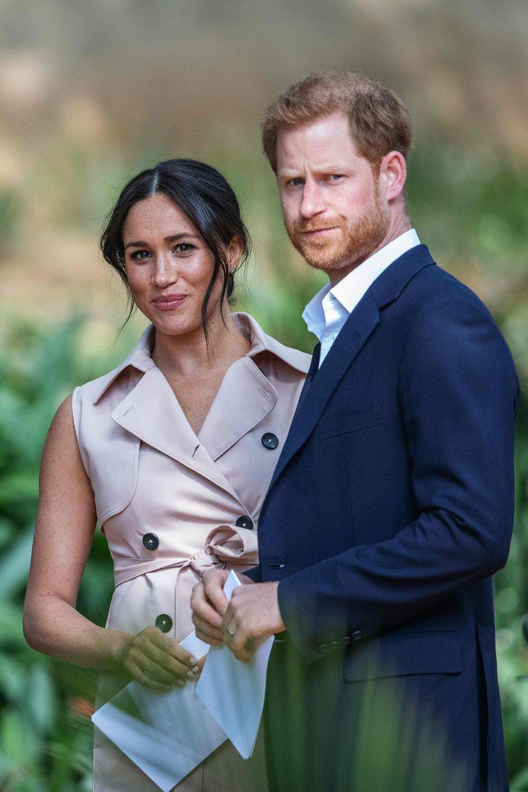 Meghan Markle en prins Harry. Beeld AFP
