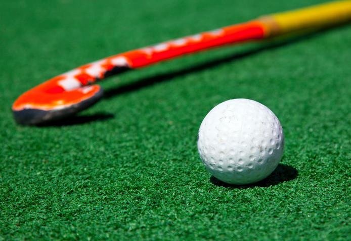 hockey stick on the field stockfoto