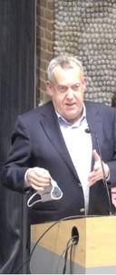 Wethouder Harry van Rooijen van Meierijstad tijdens de avond over windparken.