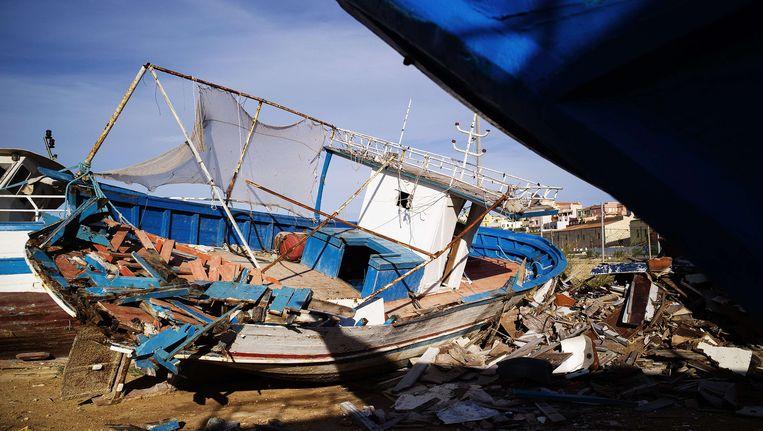 Het wrak van een boot waarmee Afrikaanse immigranten naar het eiland Lampedusa probeerden te komen. Beeld AFP