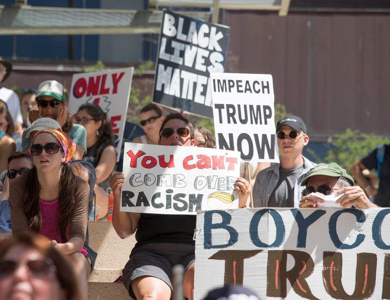 Protest in Austin, Texas, tegen racisme en tegen president Trump als reactie op het geweld in Charlottesville.  Beeld Photo News
