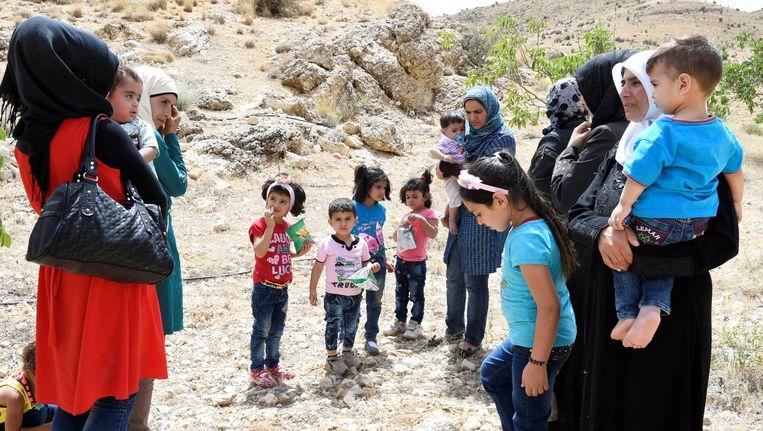 Syrische vluchtelingen hebben het kamp in Libanon verlaten en zijn teruggekeerd naar Syrië. Beeld reuters
