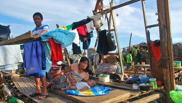 Inwoners van Cebu die hun huis zijn kwijtgeraakt. Beeld epa
