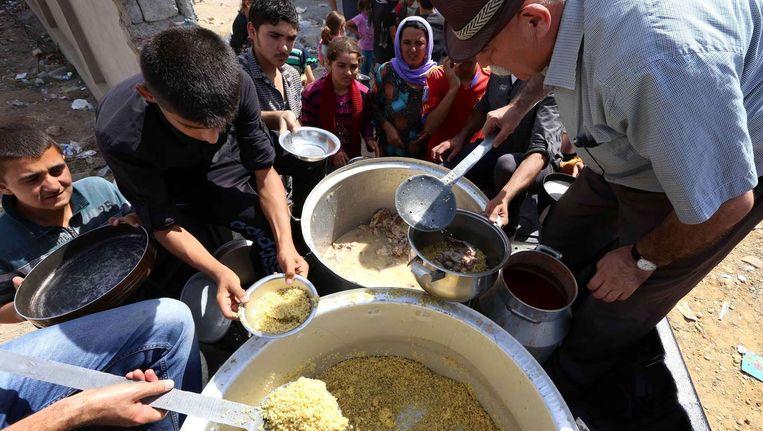 Yezidi's die het geweld in Sinjar ontvlucht zijn. Beeld AFP