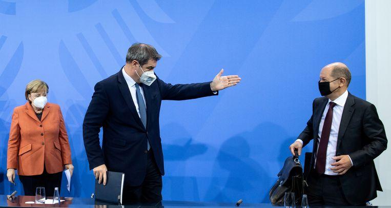 Duitse bondskanselier Angela Merkel, minister van de Duitse deelstaat Beieren Markus Söder en minister van Financiën Olaf Scholz.  Beeld REUTERS