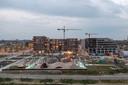 Het met appartementengebouwen steeds vollere Berlijnplein waar hijskranen naar de achtergrond zijn verdreven