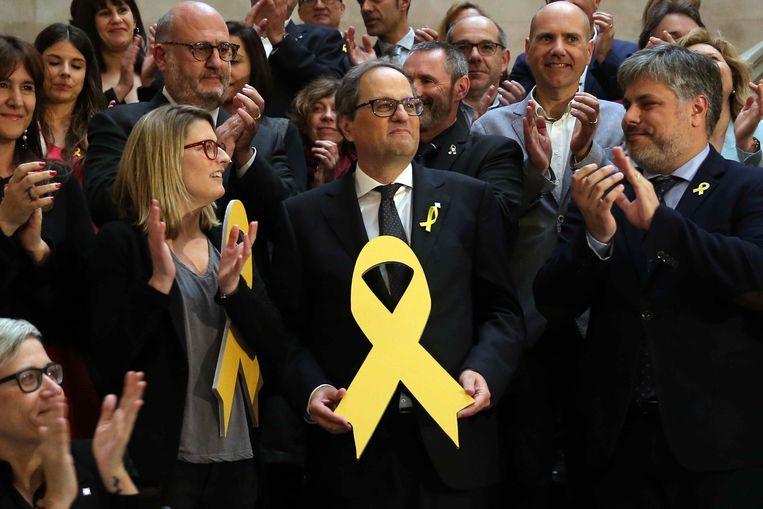 Quim Torra met het gele lint, symbool voor de Catalaanse onafhankelijkheid. Beeld EPA