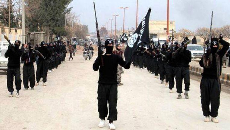 IS-strijders in de Syrische stad Raqqa. Beeld AP