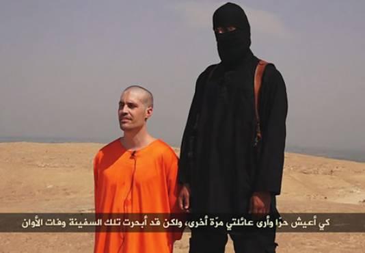 Een screenshot uit de video die IS heeft gepubliceerd van de onthoofding van James Foley