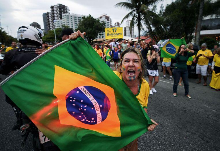 Een aanhanger van Bolsonaro in Rio de Janeiro, Brazilië. Beeld AFP