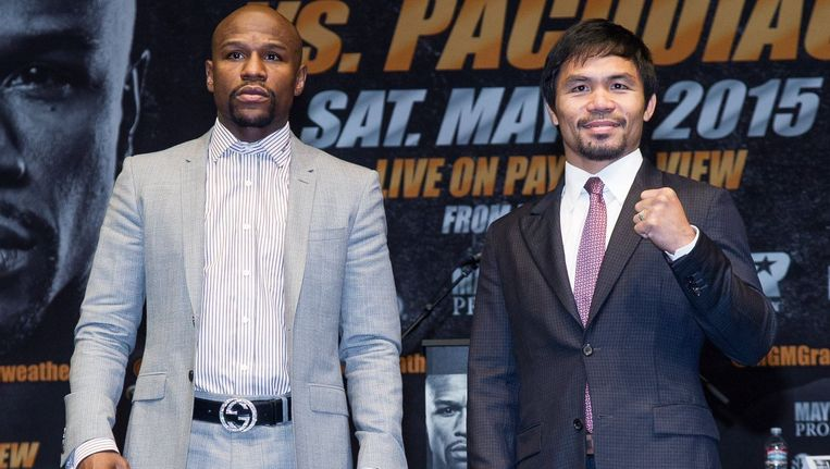 Floyd Mayweather Jr vs Manny Pacquaio vorige week tijdens een persconferentie in Los Angeles. Beeld PHOTO_NEWS