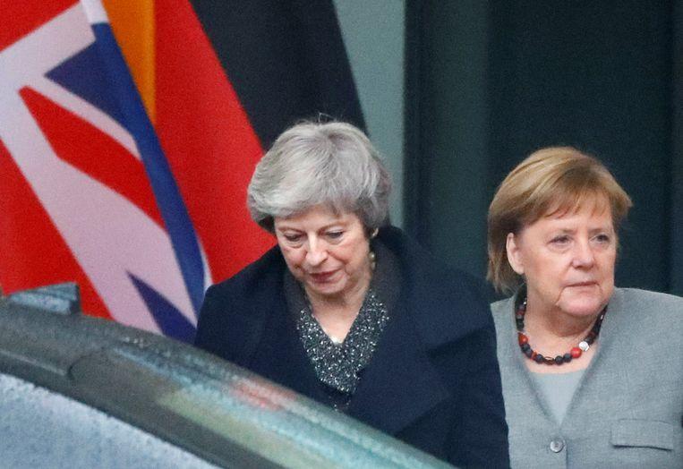 De Britse premier May op bezoek bij de Duitse bondskanselier Merkel, 11 december 2018.  Beeld Reuters
