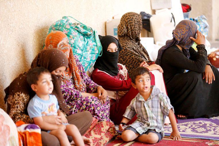 Vluchtelingen in een opvangcentrum in Garma. Beeld reuters
