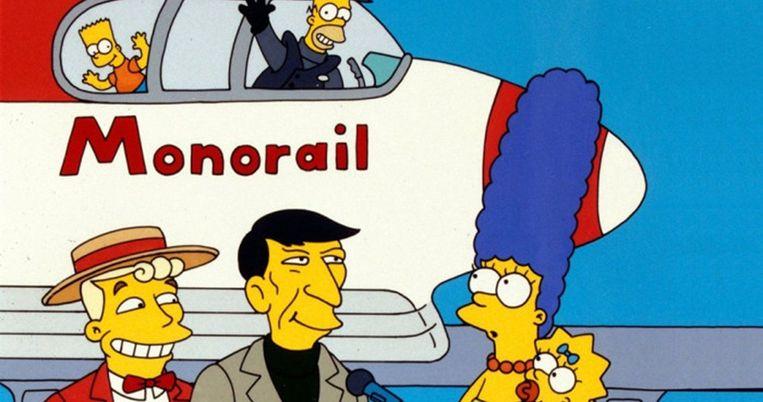 Zoon Bart en vader Homer in de Monorail, rechts vooraan moeder Marge en dochter Lisa: The Simpsons. Beeld