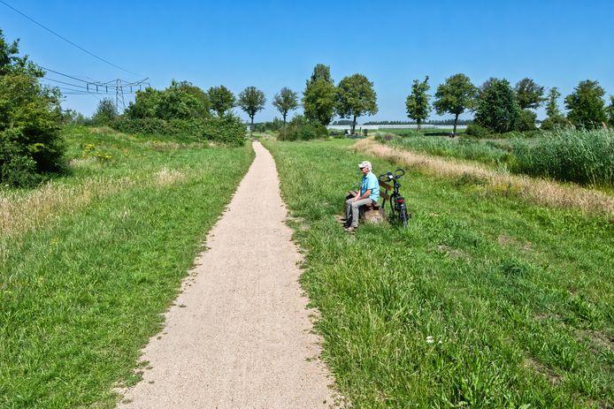 Johan Verschuren was in het verleden de drijvende kracht achter de aanleg van de groenzone tussen 's Gravenmoer en de Coca Cola-fabriek zeven kilometer verderop in De Wildert.
