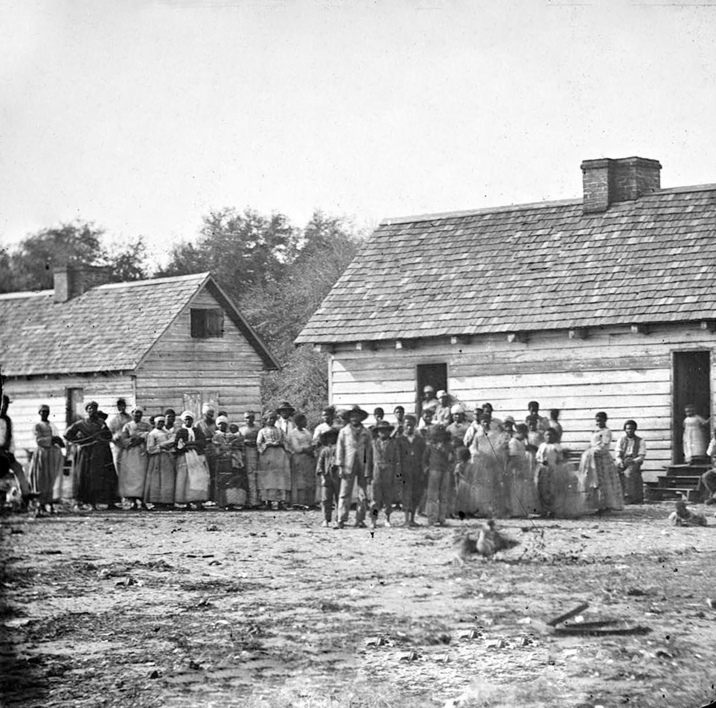 Tot slaaf gemaakte Afrikanen op een plantage in de Amerikaanse staat Virginia rond 1860.