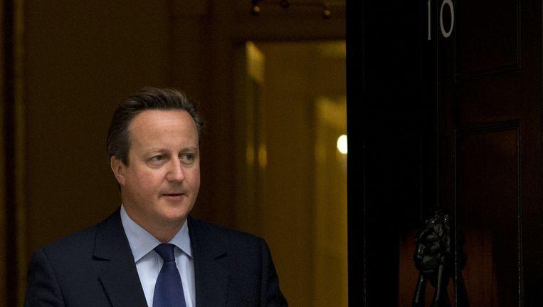Dat de Britse premier in zijn studententijd blijkbaar geestig vond zijn genitaliën even in een dode varkenskop te steken, is even voer voor hilariteit, maar zijn imago schaden zal het nauwelijks. Beeld AP
