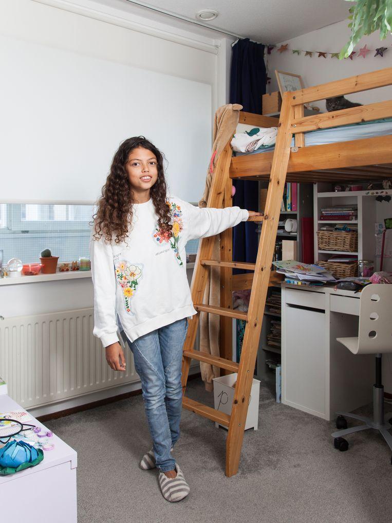 Maria De Jesus Fonseca in haar slaapkamer. Beeld Adriaan van der Ploeg