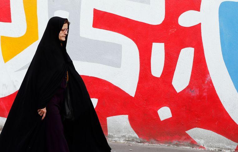 Een vrouw in Teheran. Beeld AFP