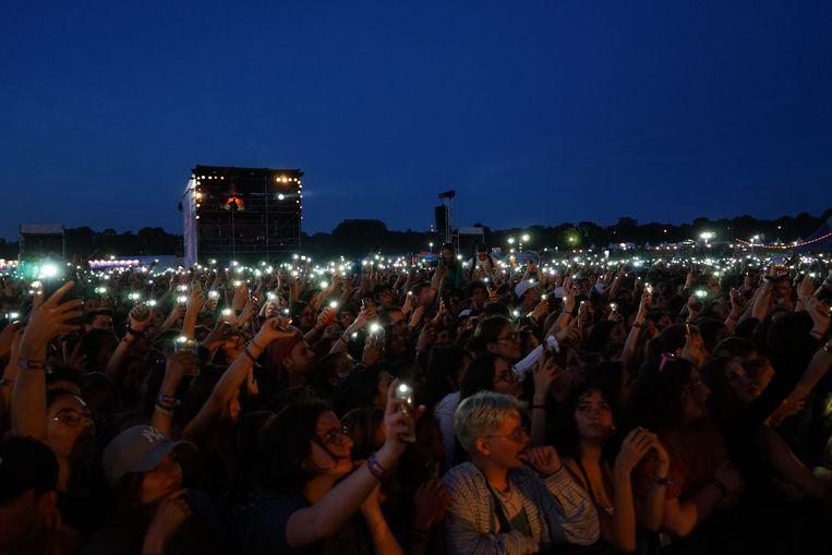 Rechtstreeks genieten van concerten zonder tussenkomst van oplichtende smartphones: zou het straks weer mogelijk zijn? Beeld AFP