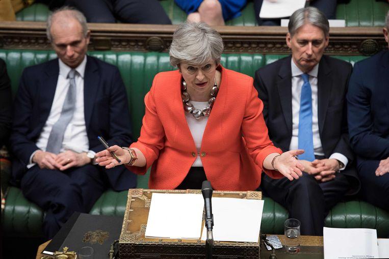 Theresa May in het Britse Lagerhuis. Beeld AFP