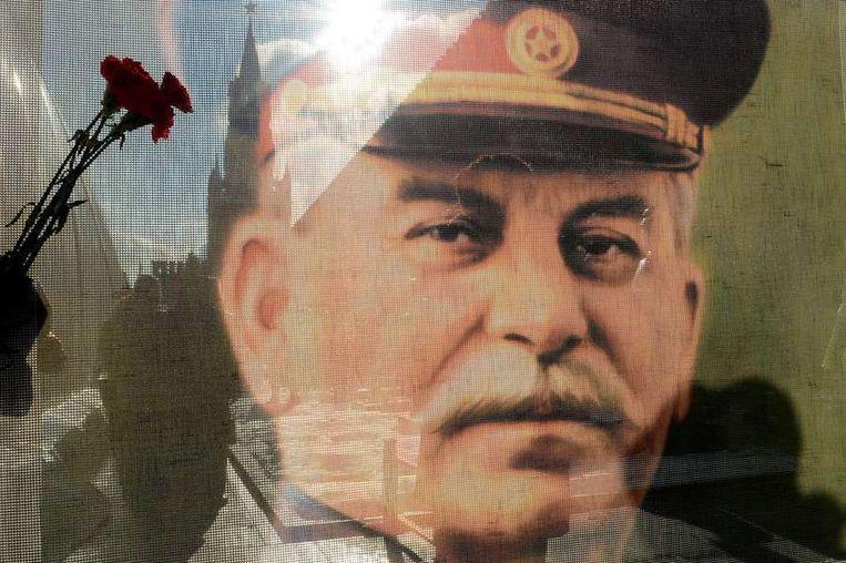 Portret van Sovjet-dictator Jozef Stalin op het Rode Plein in Moskou. Beeld afp