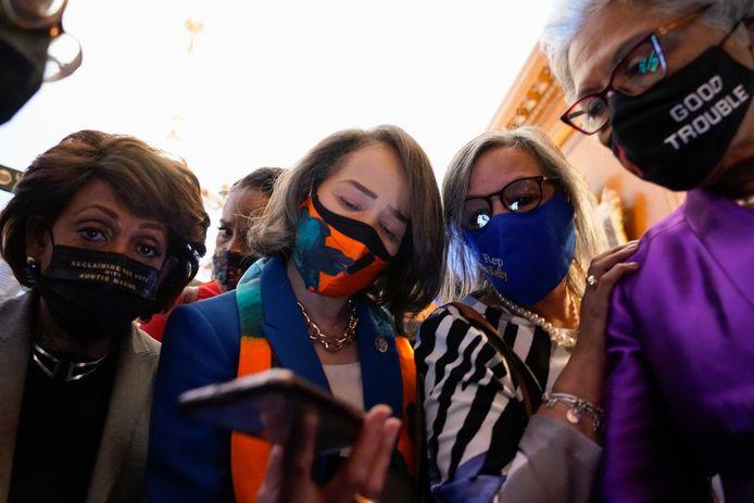 Leden van de Congressional Black Caucus luisteren op Capitol Hill in Washington naar het vonnis.