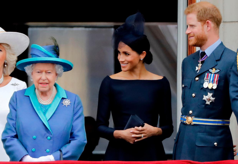 Koningin Elizabeth met Meghan Markle en prins Harry. Beeld AFP