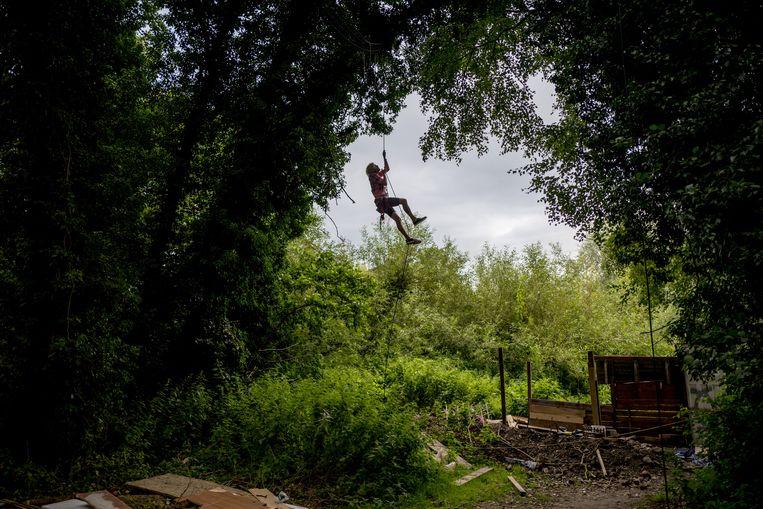 Een protestkamp tegen HS2, waar activisten in de bomen gaan wonen die ze proberen te beschermen. Beeld Hollandse Hoogte / News Syndication
