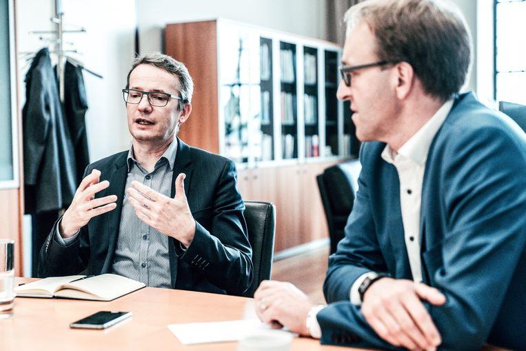 Rectoren Rik Van de Walle (UGent) en Luc Sels (KU Leuven) Beeld Thomas Sweertvaegher
