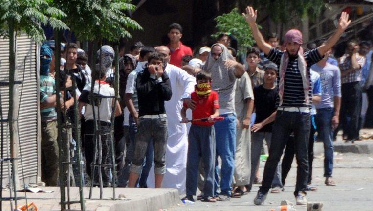 Syrische tegenstanders van de regering eerder, in een buitenwijk van Damascus. Beeld epa