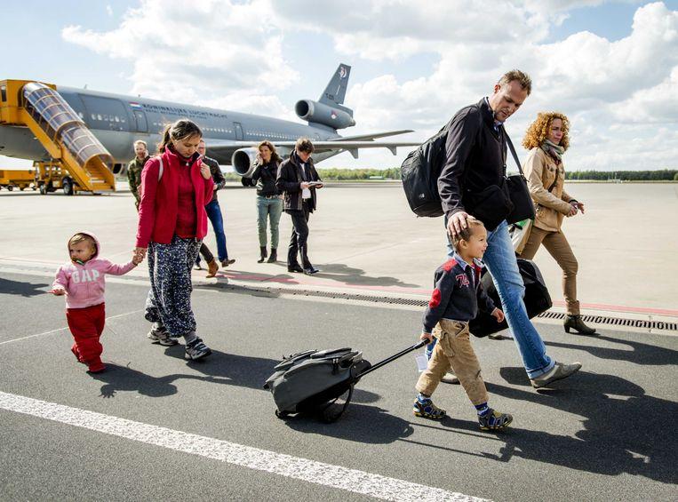 Reizigers arriveren op het vliegveld. Beeld anp
