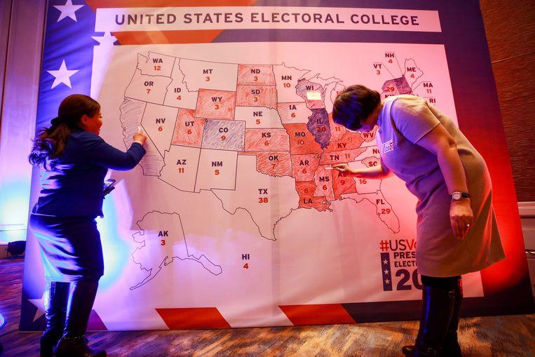 Ook in Ulaanbaatar, de hoofdstad van Mongolië, worden de Amerikaanse verkiezingen op de voet gevolgd. Beeld AFP