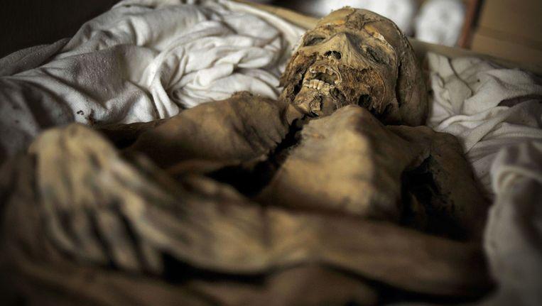 Een van de 265 mummies die in Vac werden gevonden. Beeld ap