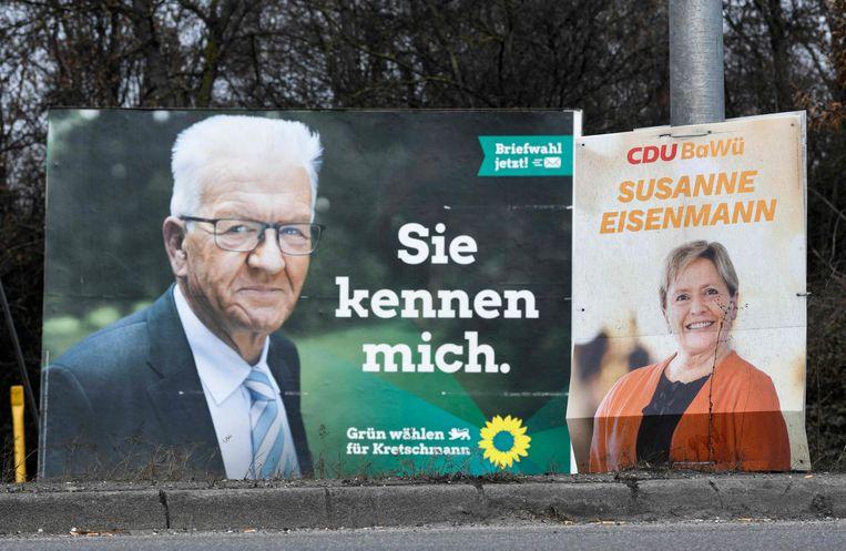 Verkiezingsaffiches van lijsttrekkers Winfried Kretschmann (de Groenen) en Susanne Eisenmann (CDU) voor de deelstaatverkiezingen in Baden-Württemberg van zondag 14 maart. Beeld AFP