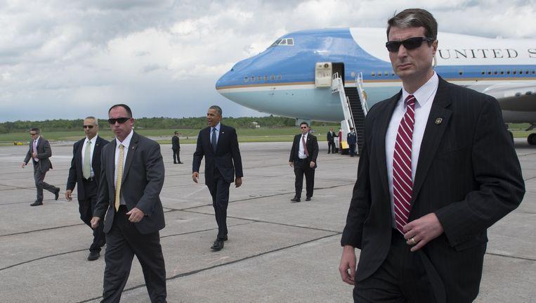 Obama omringd door Secret Service Beeld afp