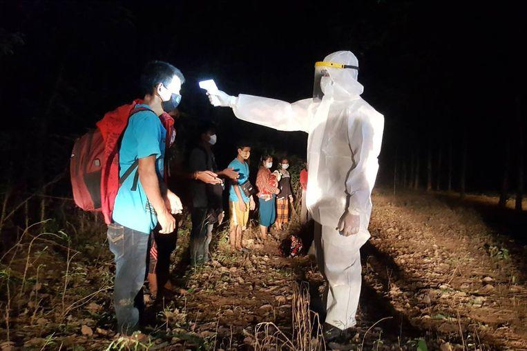 Alleen bij binnenkomst aan de Cambodjaanse grens werd getest. Beeld AFP