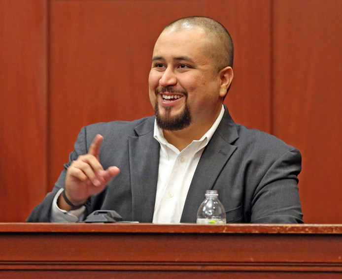 George Zimmerman lacht als hij wordt vrijgesproken.