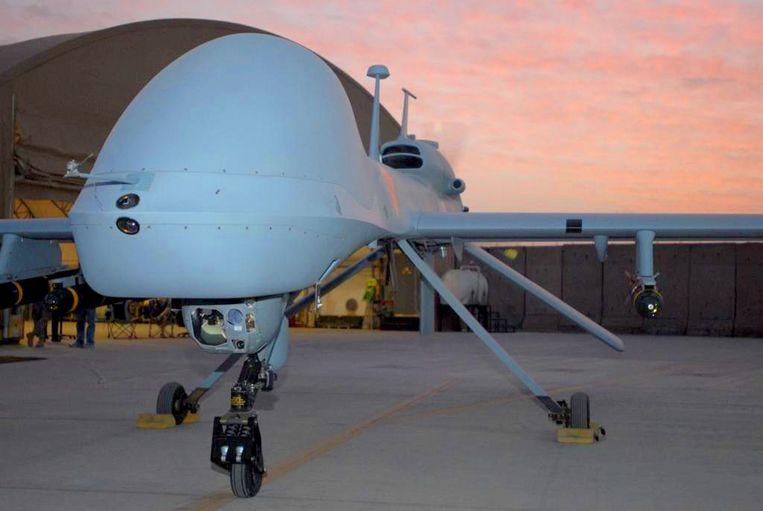 Een Amerikaanse MQ-1C Gray Eagle-drone met Hellfire-raketten op een luchtmachtbasis in Irak. Beeld afp
