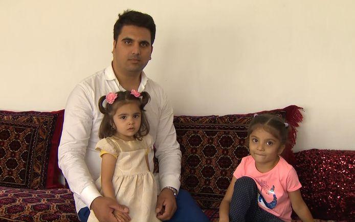 Hejrat en zijn twee dochters Zala en Sana in Kortrijk.