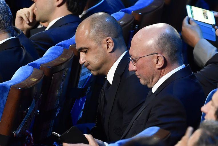 Technisch directeur Chris Van Puyvelde en bondscoach Roberto Martínez tijdens de loting. Beeld BELGA