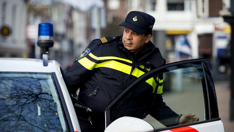 Zestig politieauto's in actie voor betere cao. Beeld anp