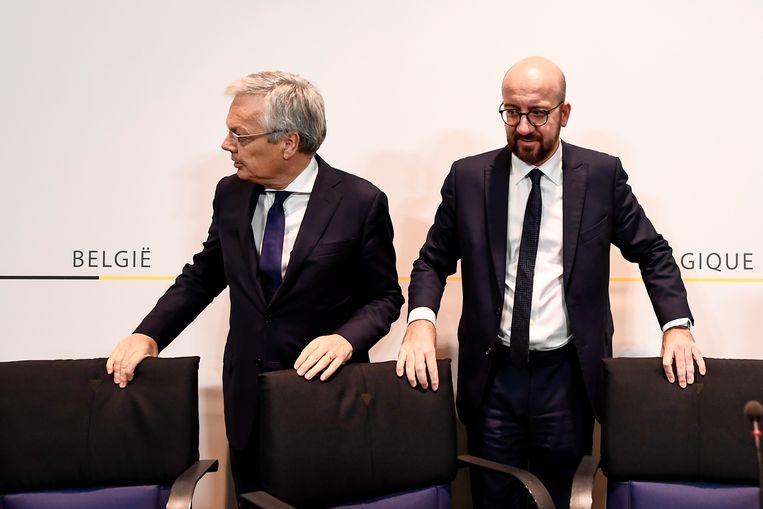 Didier Reynders (MR) met zijn premier en partijvoorzitter Charles Michel (r.). Beeld BELGA